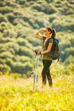 Young woman is hiking in mountain and enjoying nature.