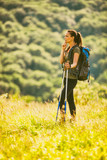 Young woman is hiking in mountain in summertime. - 193572676
