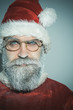 Serious Santa Claus. Christmas, New Year, holiday, emotion, facial expressions and people concept - excited amased Santa in glasses wearing Christmas costume. Winter holiday and surprise concept.
