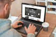Web designer designs a modern flat website on a laptop. Coffee beside.