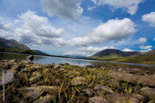 Mountain lake with the clouds on the blue sky in Ireland