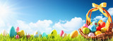 Easter Eggs in a Basket on Green Grass and Blue Sunny Sky - 193591460
