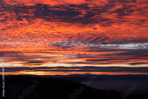 Fotobehang Koraal Pink glowing sunset sky over the mountain, Kopitoto Hill, Vitosha Mountain, Sofia, Bulgaria