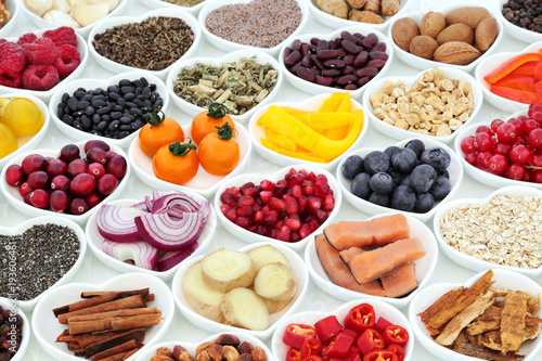 Super food nutrition for a healthy heart with fruit, vegetables, fish, cereals, seeds, nuts. spice and herbal medicine. Foods very high in antioxidants, omega 3,  fibre, anthocyanins & vitamins. © marilyn barbone