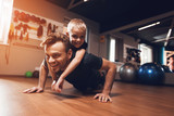Father and son in the gym. Father and son spend time together and lead a healthy lifestyle. - 193608474