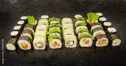 Tuinposter Sushi bar Vegetarian sushi and roll set with vegetables. Japanese food