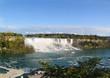 Niagara fall Horseshoe. Ontario. Canada. Beautiful waterfall on blue sky and white clouds background.