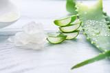 Aloe Vera gel closeup. Sliced Aloevera natural organic renewal cosmetics, alternative medicine. Organic skincare concept. On white wooden background - 193676252