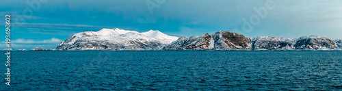 Papiers peints Bleu vert View of the ridge of snow-covered mountains from the sea. Panorama.
