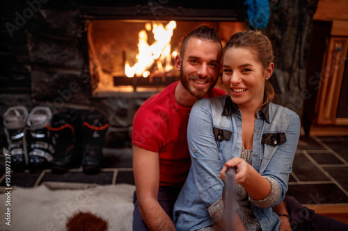 Time of relaxing after skiing- couple making selfie together
