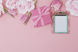 Pink Gift Background with Spring Flowers and Blank Note