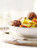 Tagliatelle with vegetables and meatballs - 193738255