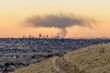 Smoke Cloud Over Denver - A huge thick cloud of black smoke, from a fire in Downtown area, hovering over the city's evening skyline, seen from a hilltop of Lakewood. CO, USA. January  09, 2018.
