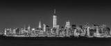 New York City Manhattan downtown skyline at dusk with skyscrapers illuminated over Hudson River panorama. Horizontal composition, black and white image. - 193744438