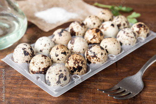 uncooked quail eggs on classic rustic wood Poster