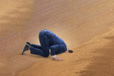 Businessman hiding his head in sand escaping from problems - 193757435