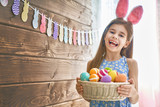 Girl holding basket with eggs - 193757678