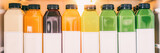 Juice bottles for detox cleanse juicing trend - Healthy diet food delivery at home in fridge banner panorama. Selection of cold press vegetable and fruit juices, orange, lemon, beets, spinach.