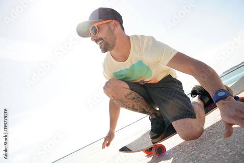 Fotobehang Skateboard Trendy guy riding skateboard