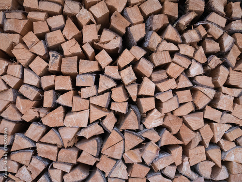Keuken foto achterwand Brandhout textuur Wall of chopped logs saved for winter fire or heating.