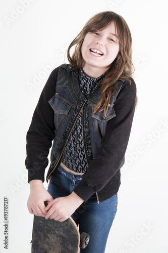 Fotobehang Skateboard Portrait of a smilng adorable preschool girl with long board or skate