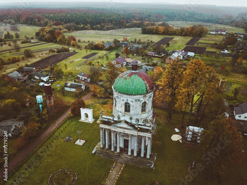 Old abandoned deserted church and  castle, village and mountains in Ukraine. Aerial view