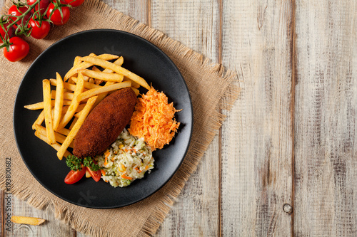 Aluminium Kiev Chicken Kiev (de Volaille chop) with french fries and salads.