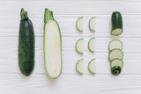 Zucchini is shredded on the white wooden background, top view. - 193800831