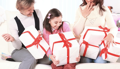 girl shares with the family with holiday gifts