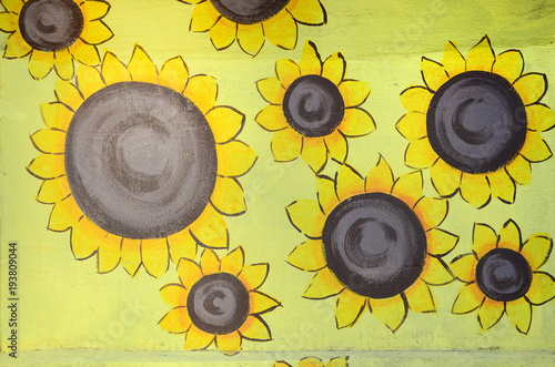 Background texture of wall with graffiti paintings. Yellow sunflowers