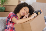 woman exhausted by house moving - 193812027