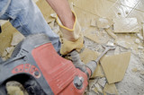 Removing old floor tiles - 193814299