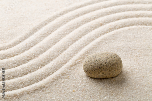 Papiers peints Zen Zen sand and stone garden with raked curved lines. Simplicity, concentration or calmness abstract concept