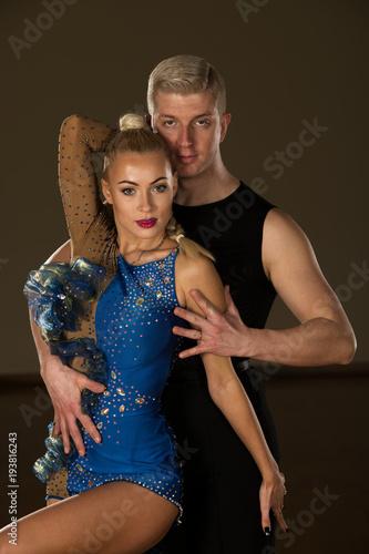 Beautiful professional latin dance couple preform exhibition dance