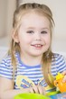 Cute little girl playing and having fun with clay, plastiline