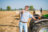 Smiling farmer giving thumbs up - 193821871