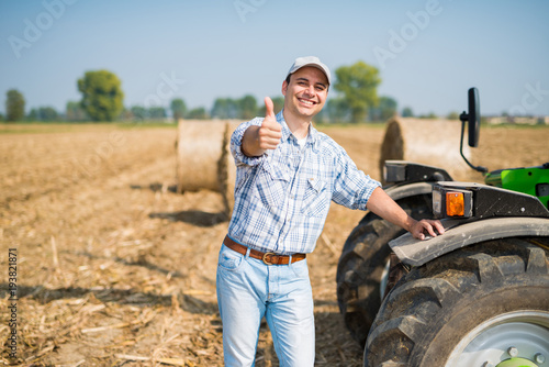 Smiling farmer giving thumbs up