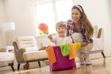 Daughter and mother cleaning home together and having fun. - 193838862