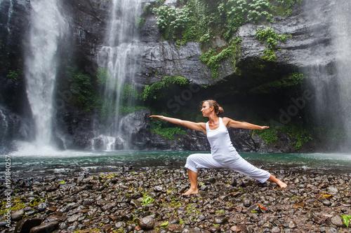 Aluminium School de yoga Woman practices yoga near Sekumpul waterfall in Bali, Indonesia