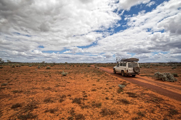 South Australia – Outback desert with 4WD track under cloudy sky as panorama