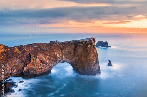 Dyrholaey rock formation at sunset. Dyrholaey is a promontory located on the south coast of Iceland, not far from the village Vik