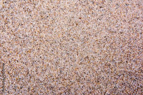 Foto op Canvas Stenen Gruby piasek morski