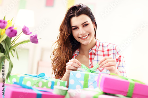 Attractive woman with Easter presents - 193853482