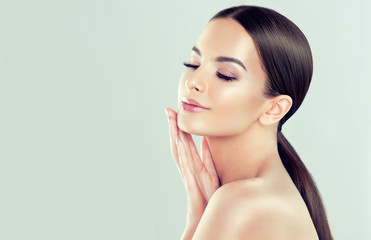 Beautiful young woman with clean fresh skin  .Girl  beauty face care. Facial  treatment   .