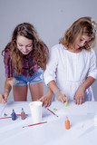 Cute children painting pictures. (talent, creativity, development, learning, childhood concept)
