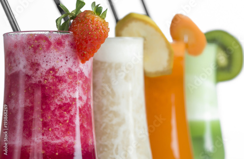 Foto op Canvas Sap strawberry ,kiwi, carrot and banana smoothie on white background