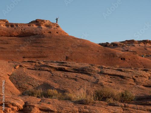 Foto op Canvas Diepbruine Boy on sandstone rock