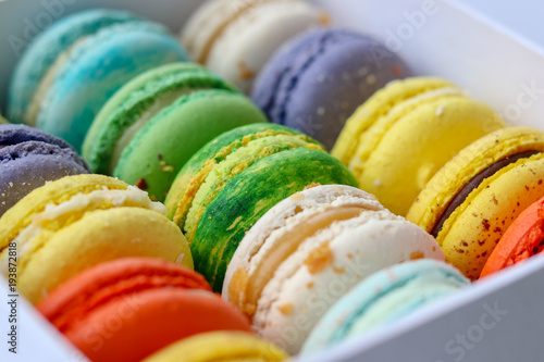 Assortment of colored bright tasty macaroons in the box, close-up Poster