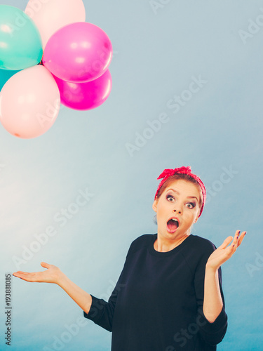 Smiling crazy girl having fun with balloons.