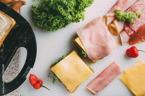 Toast sandwich preparation. Top view.  Caprese salad on sticks.